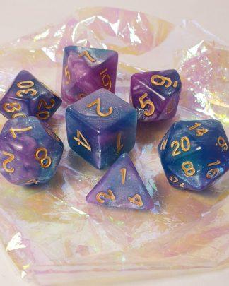 Purple aqua blue nebula galaxy effect polyhedral dungeons and dragons dice set