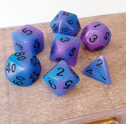 Glow in the dark purple and blue dungeons and dragons polyhedral dice set